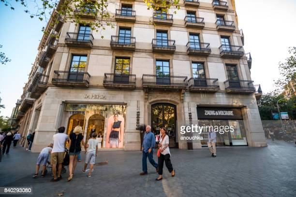 Luxury shops at Passeig de Gracia, shopping street in Barcelona, Spain
