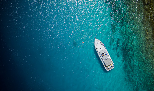 Luxury small yacht anchoring in shallow water 1007172594