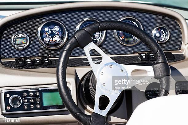 Luxury speedboat control panel with steering wheel, front view