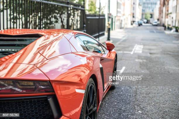 luxury sport cars on the streets of london - lamborghini stock photos and pictures