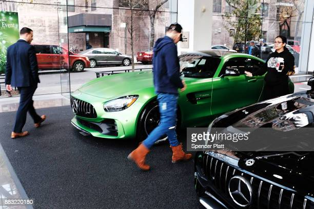 A luxury sports car sits on display in a dealership in Manhattan on November 30 2017 in New York City Republicans are coming closer to getting the...