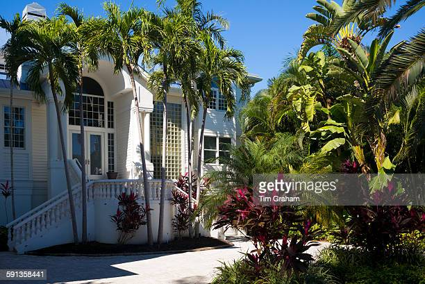 Luxury stylish winter home surrounded by palm trees on Captiva Island in Florida USA