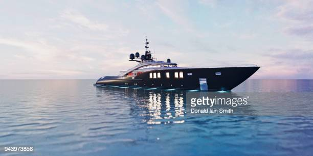 luxury super yacht in calm sea at dusk - luxury yacht stock pictures, royalty-free photos & images
