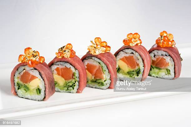 luxury sushi rolls with gold leaves - maki sushi stock pictures, royalty-free photos & images