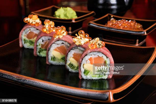 luxury sushi rolls with gold leaves - wasabi stock pictures, royalty-free photos & images