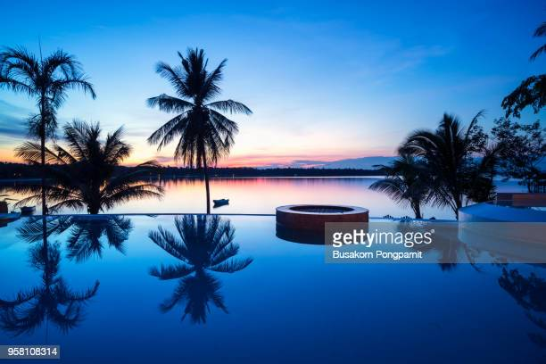 luxury swimming pool at sunset - standing water stock pictures, royalty-free photos & images