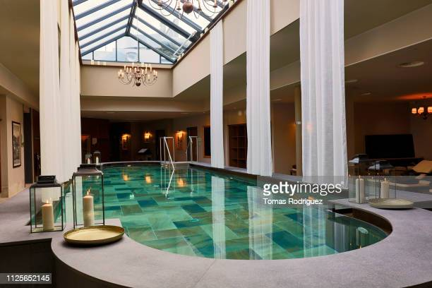 luxury swimming pool in a spa with skylight - health farm stock pictures, royalty-free photos & images