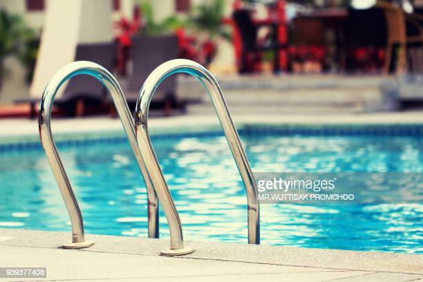 luxury swimming pool.way down the stairs of the pool. - poolside stock pictures, royalty-free photos & images