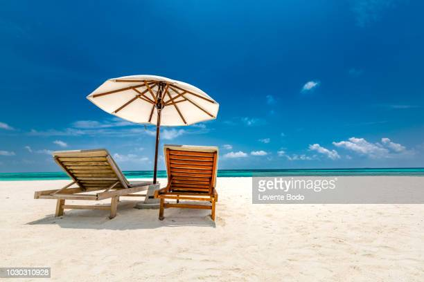 luxury travel background, lounge chair sand amazing summer beach mood - outdoor chair stock pictures, royalty-free photos & images