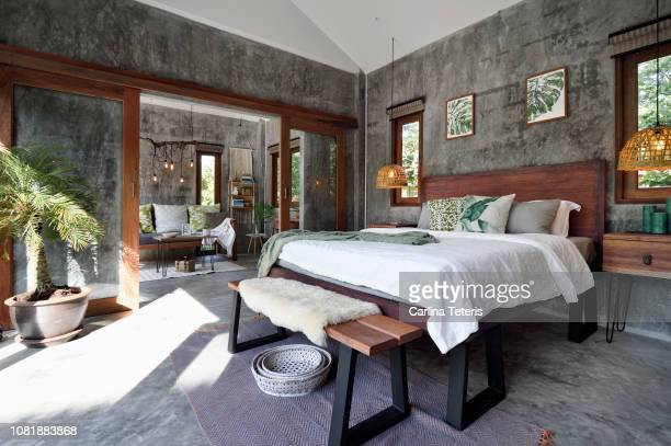 luxury tropical resort bedroom - luxury hotel stock pictures, royalty-free photos & images