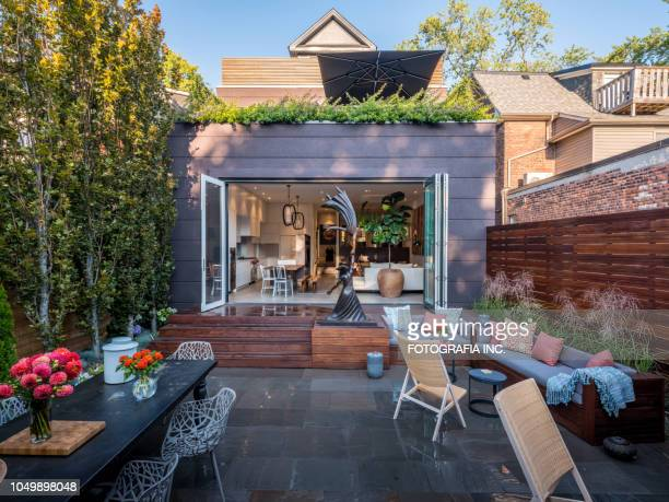 luxury urban home backyard exterior - real estate developer stock pictures, royalty-free photos & images