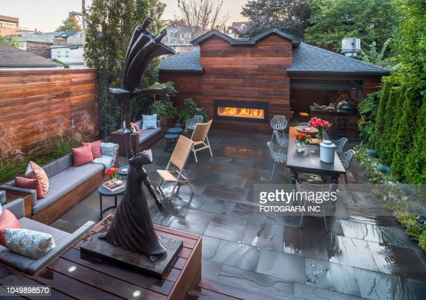 luxury urban home backyard exterior - build grill stock photos and pictures