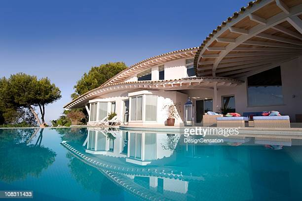 luxury villa and pool - mediterranean culture stock pictures, royalty-free photos & images