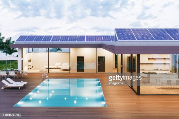 luxury villa with solar panels - solar energy stock pictures, royalty-free photos & images