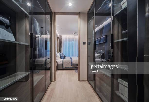 luxury walk-in closet - closet stock pictures, royalty-free photos & images