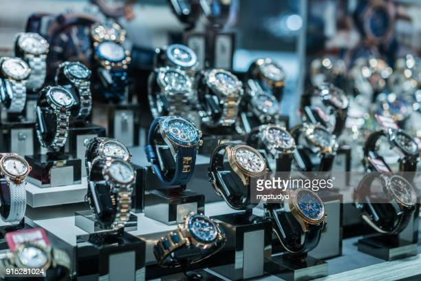 luxury watches  at showcase - collection stock pictures, royalty-free photos & images