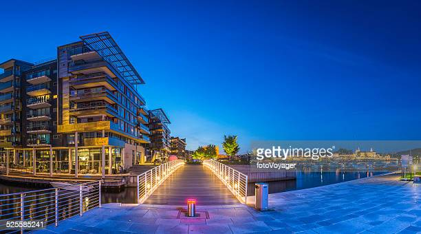 Luxury waterfront apartments restaurants overlooking harbour Aker Brygge Oslo Norway