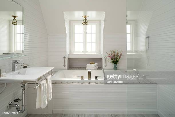 luxury white bathroom with bathtub - bathroom stock pictures, royalty-free photos & images