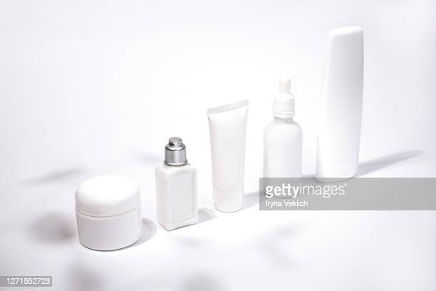 luxury white cosmetic products on white background. - 化粧品 ストックフォトと画像