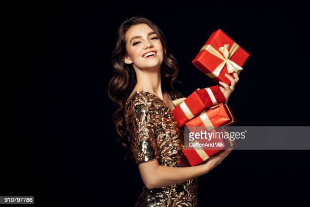 luxury woman with a gift - christmas gifts stock photos and pictures