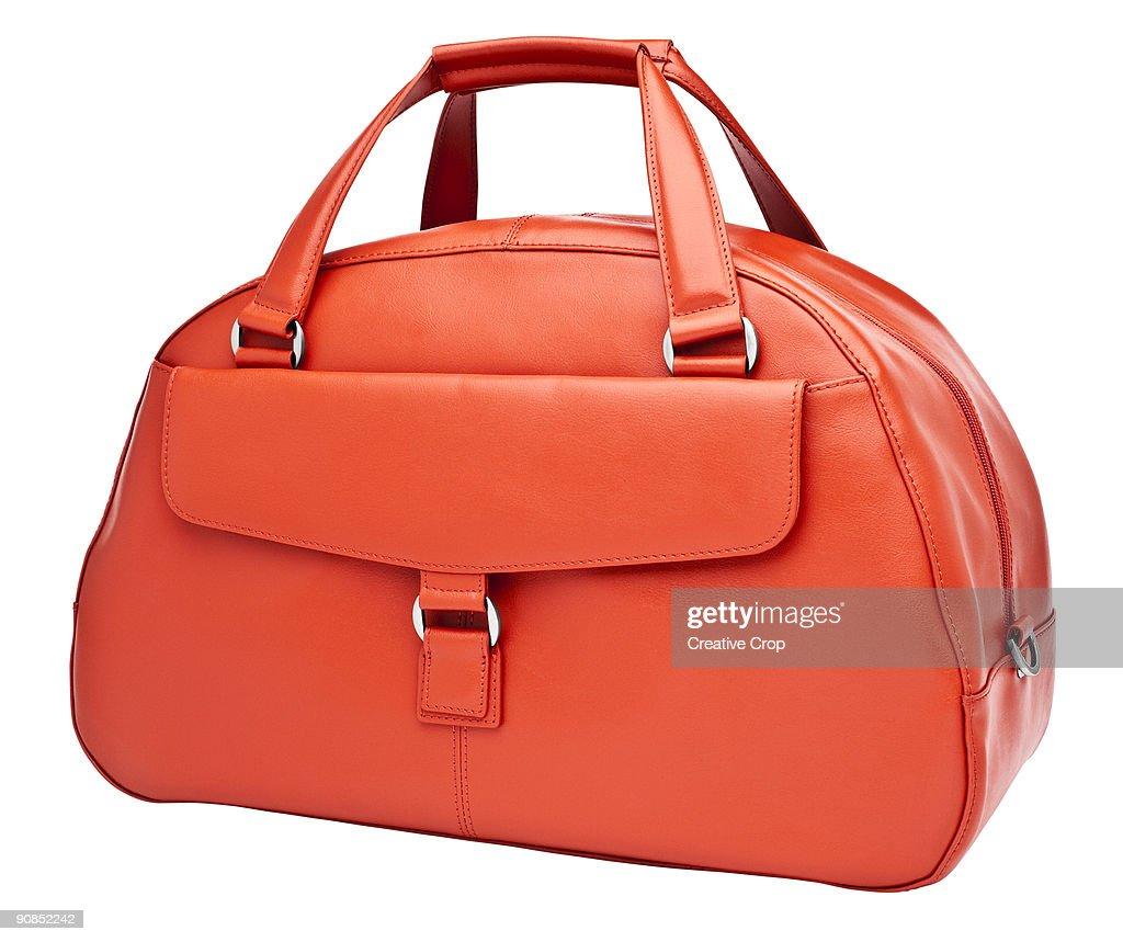 Luxury woman's orange leather handbag : Stock Photo