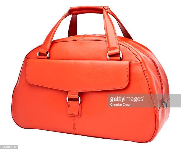 luxury woman's orange leather handbag - clutch bag stock pictures, royalty-free photos & images