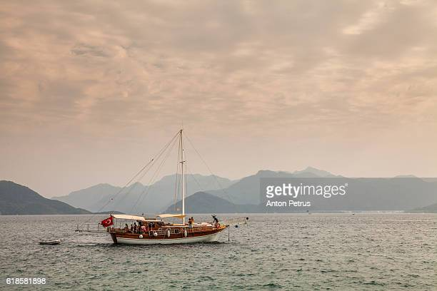 Luxury yacht in Mediterranean sea on mountain background