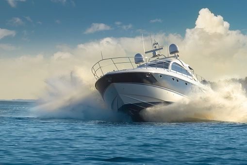 A luxury yacht in motion on the water 147701287