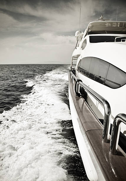 Luxury yacht sailing at high speed in the ocean