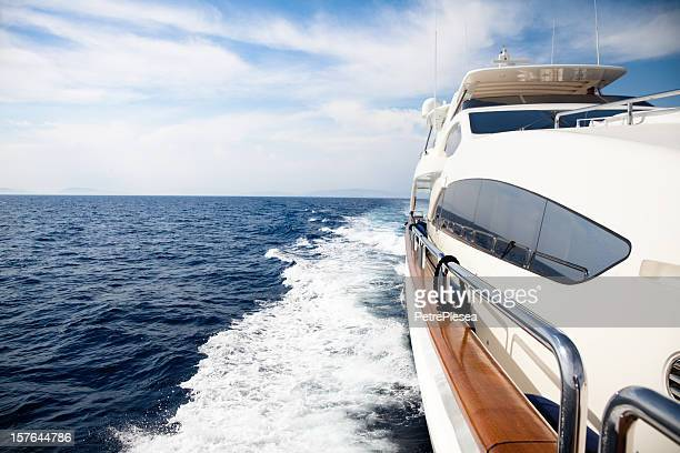 luxury yacht sailing at sea - luxury yacht stock pictures, royalty-free photos & images