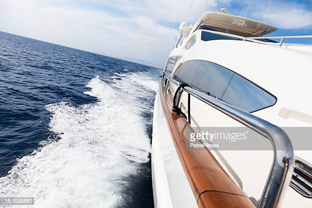 Luxury yacht sailing  at sea with high speed