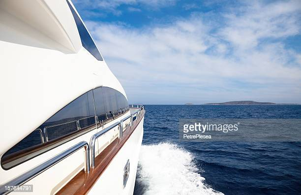 luxury yacht sailing in the ocean - luxury yacht stock pictures, royalty-free photos & images