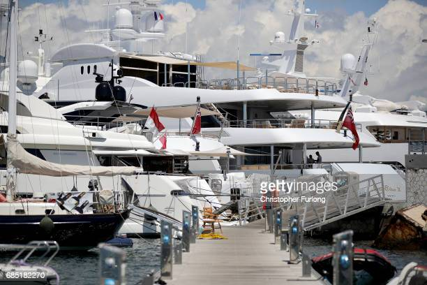 Luxury yachts berth next to the Palais de Festivals as owners and movie company's chartering the yachts attend the Cannes Film Festival on May 19...