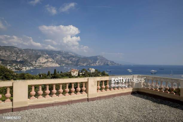 Luxury yachts sit on the Mediterranean as the coastline is seen from the roof top of the Villa Les Cedres a 187yearold000squarefoot 14bedroom mansion...