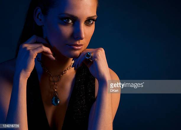 luxury young dark-haired girl in exclusive jewelry