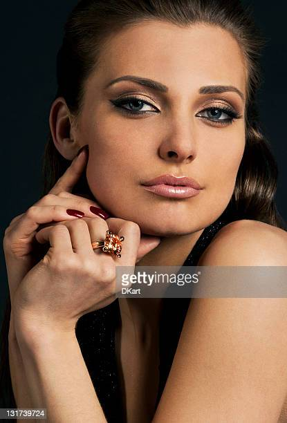 luxury young dark-haired girl in exclusive jewelry - topaz stock photos and pictures
