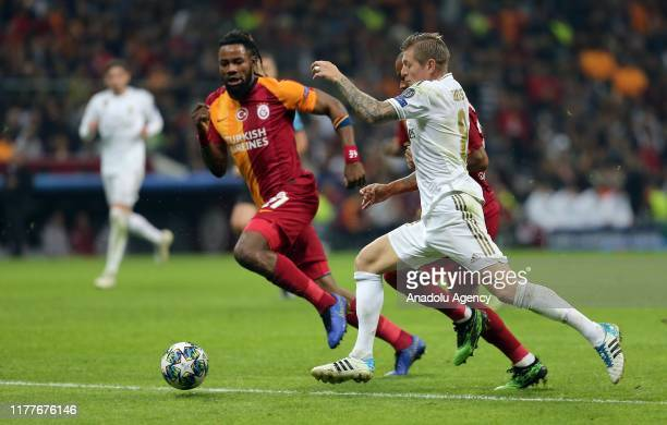 Luyindama of Galatasaray in action against Toni Kroos of Real Madrid during the UEFA Champions League Group A match between Galatasaray and Real...