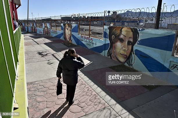 Luz del Carmen Flores mother of disappeared Luz Angelica Mena Flores observes the memorial wall of missing girls one of them her daughter in Ciudad...