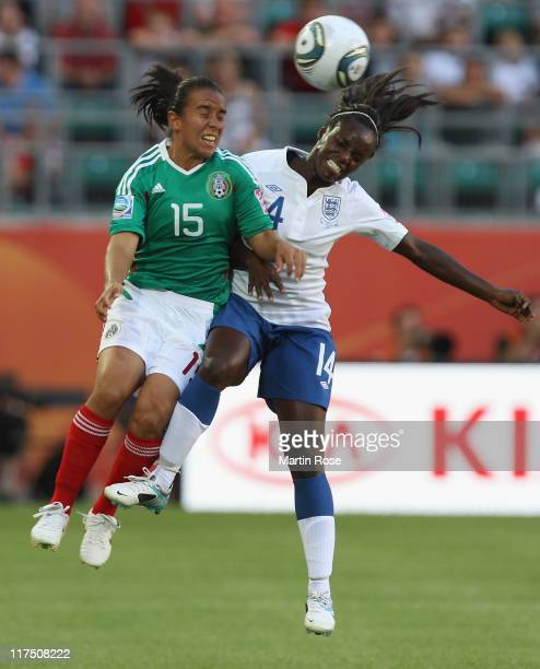 Luz del Rosario Saucedo of Mexico and Eniola Aluko of England head for the ball during the FIFA Women's World Cup 2011 Group B match between Mexico...