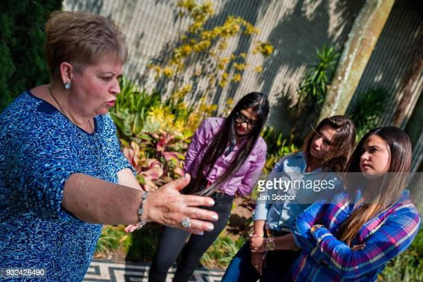 Luz María Escobar the sister of the drug lord Pablo Escobar talks to the audience while visiting her brothers tomb at the cemetery of Montesacro in...