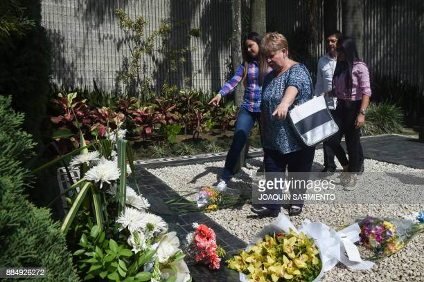 Luz Maria Escobar Gaviria, sister of druglord Pablo Escobar, places flowers on his grave on the 24th anniversary of his death at the Montesacro...