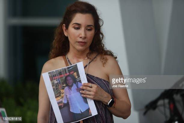 Luz Marina holds a picture of her aunt, Marina Azen, who she said is missing after the partial collapse of the 12-story Champlain Towers South condo...