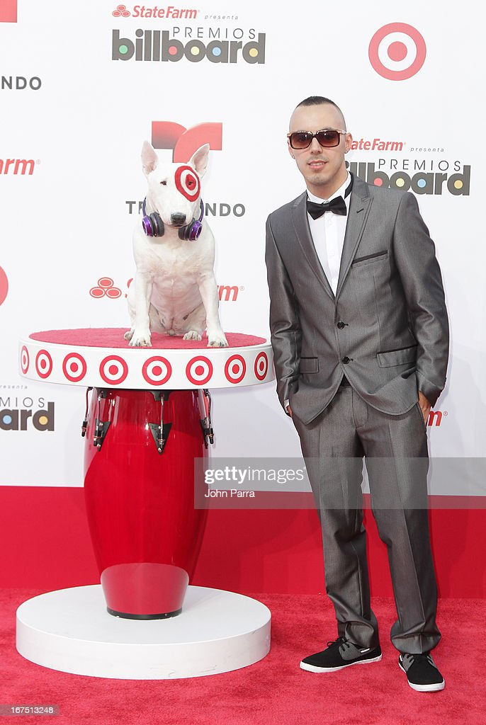 Luzenzo celebrates with Bullseye, Target's Beloved Bull Terrier Mascot, at the 2013 Billboard Latin Music Awards at BankUnited Center on April 25, 2013 in Miami, Florida.