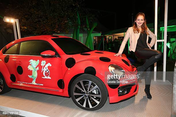 Luzie Seitz, daughter of Max Tidof next to a beetle car during the 'Tabaluga - Es lebe die Freundschaft' record release at Das Schloss on October 28,...