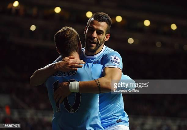 Álvaro Negredo of Manchester City celebrates scoring their first goal in extra time with Edin Dzeko of Manchester City during the Capital One Cup...
