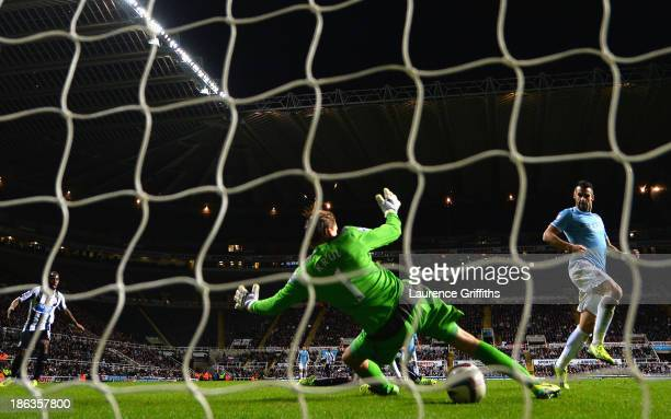 Álvaro Negredo of Manchester City scores their first goal past Tim Krul of Newcastle United during the Capital One Cup Fourth Round match between...