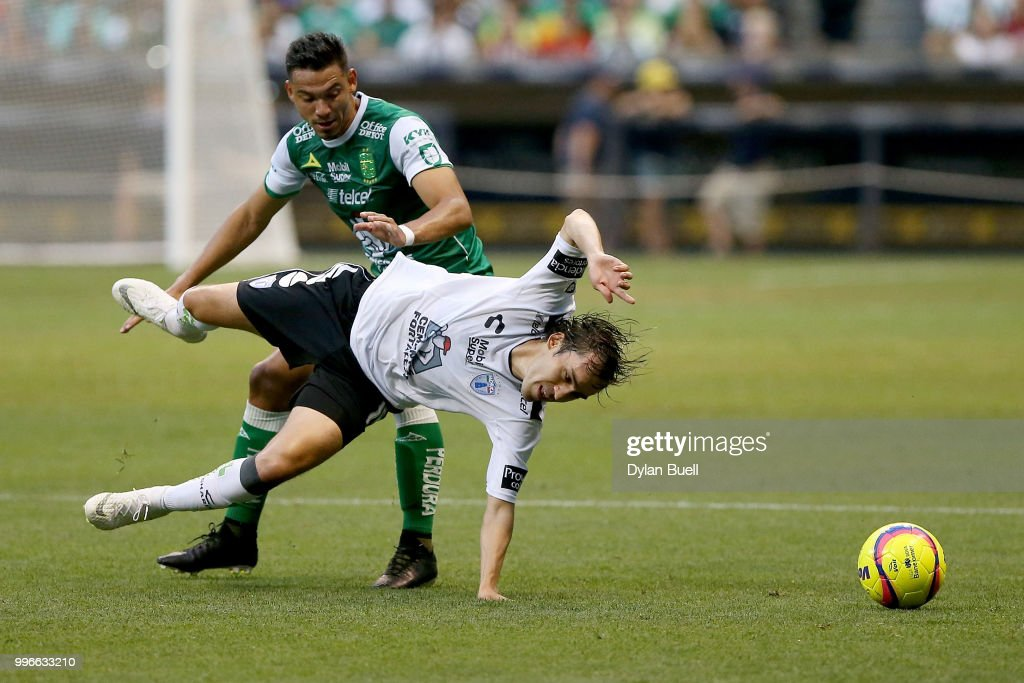 Alvaro Ramos #9 of Club Leon fouls Jose Joaquin Martinez #18 of CF Pachuca in the first half at Miller Park on July 11, 2018 in Milwaukee, Wisconsin.