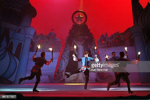 LVKidsleaping2KH12/15/95Skaters carry torches in a dramatic number for Lords a Leaping in The Twelve Days of Christmas ice show at Knotts Berry Farm...