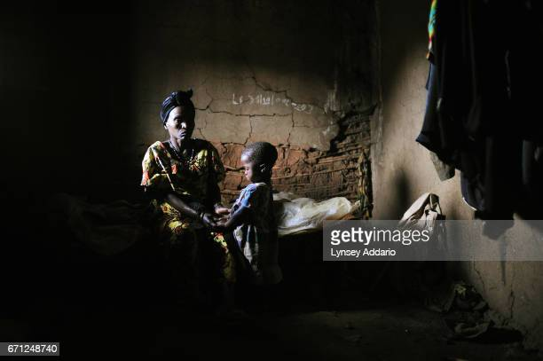 Lwange sits with her three year old child Florida in the village of Kayna in their home in North Kivu in Eastern Congo April 12 2008 Florida was...