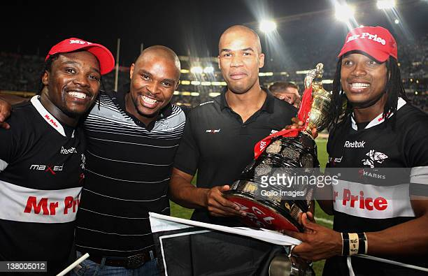Lwazi Mvovo Luzuko Vulindl JP Pietersen and Odwa Ndungane pose with the trophy after the Absa Currie Cup final match between the Sharks and Vodacom...